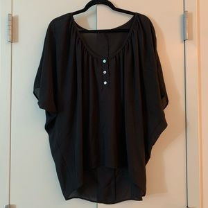 Black blouse with three buttons, high low seam.